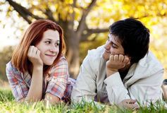 Young couple at grass in the park. Stock Photo