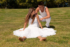 Young couple on grass white love relationship royalty free stock photos