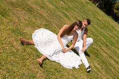 Young couple on grass white love relationship royalty free stock photography