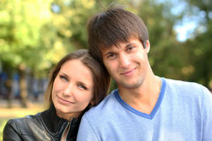 Young couple on a green background of the park Royalty Free Stock Photos