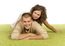 Young couple on green carpet Royalty Free Stock Photos