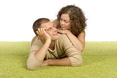 Young couple on green carpet Stock Photos