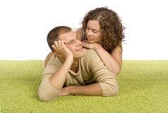 Young couple on green carpet Stock Photos