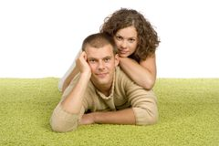 Young couple on green carpet Royalty Free Stock Photo