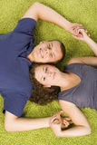 Young couple on green carpet Royalty Free Stock Image