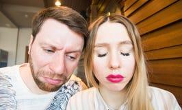 Young couple grimacing, sad faces Royalty Free Stock Photos