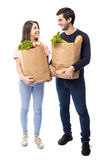 Young couple with grocery bags Royalty Free Stock Images
