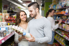 Young couple at grocery Royalty Free Stock Image