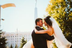 Young couple groom and the bride on the park background. Stock Images