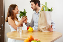 Young Couple with Grossery Bag full of Vegetables. Healthy Lifes Royalty Free Stock Image