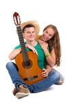 Young couple with guitar Royalty Free Stock Images
