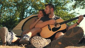 Couple with guitar on nature stock video footage