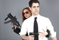 Young couple with guns Royalty Free Stock Images