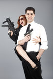 Young couple with guns Stock Images