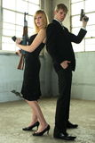 Young couple with guns. Stock Photo