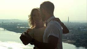 Young couple, guy holding woman in arms, looking at each other, dance pose stock images
