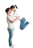 Young couple, guy with jumping up girl, studio, isolated Royalty Free Stock Image
