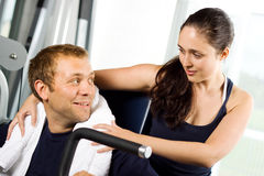 Young couple in the gym Stock Images