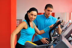Young couple in the gym Royalty Free Stock Images