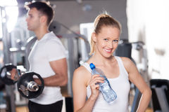 Young couple at the gym. Young couple in health club Royalty Free Stock Photography
