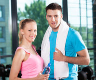 Young couple at the gym Stock Images