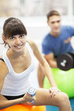 Young couple in a gym Stock Image