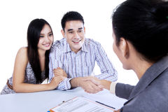 Young couple hand shake with businesswoman Royalty Free Stock Image