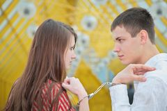 Young couple with handcuffs Royalty Free Stock Photography