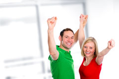 Young couple with hands with arms up Stock Photos