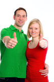 Young couple with hands with thumbs up Royalty Free Stock Photos