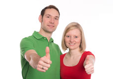 Young couple with hands with thumbs up Stock Images
