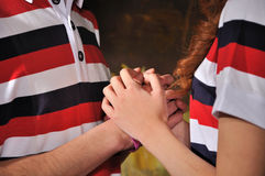 Young couple hands together Royalty Free Stock Photo