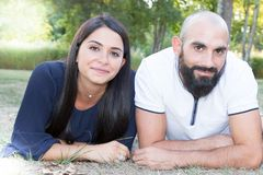 Couple handsome beard bald man and pretty brunette long hairs girl. Young couple handsome beard bald men and pretty brunette long hairs girl stock photography