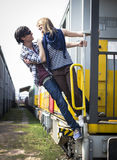 Young couple hanging from the train Stock Photo
