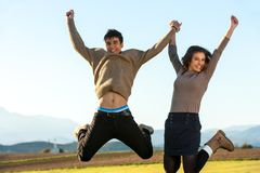 Young couple hanving fun jumping. Stock Photo