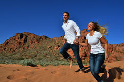 Young Couple Happily Running Together Stock Photo