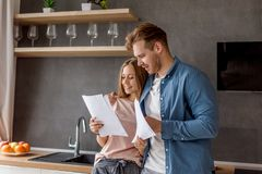 Young couple is happy as they has finished to pay for a loan royalty free stock photography