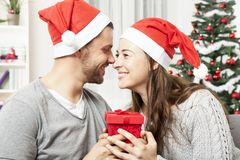 Young couple is happy with gift for christmas Stock Images
