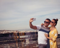 Young couple happy in love taking selfie self-portrait photo. Happy couple selfie selfportrait in front of Barcelona, Spain. Travel couple having fun on Europe Stock Photography
