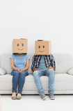 Young couple with happy smiley boxes over faces Royalty Free Stock Image