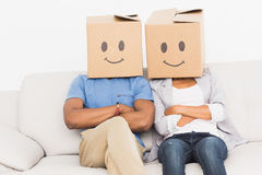 Young couple with happy smiley boxes over faces Stock Photo