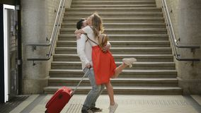 Young Couple Happy To Meet Again In The Train Station. Girl Runs To Meet Her Boyfriend. stock footage