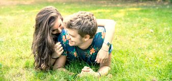 Couple has fun in the park Royalty Free Stock Images