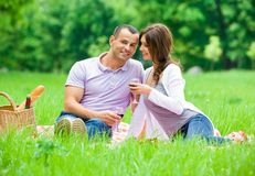 Young couple has picnic in park Royalty Free Stock Images