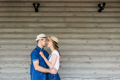 Young couple with hats. Stock Image
