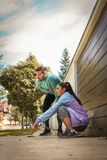 Young couple have break after running. Young couple have break on sidewalk after running. Young couple Stock Photography