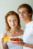 Young couple have breakfast in bed Royalty Free Stock Images