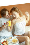 Young couple have breakfast in bed Stock Photography