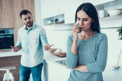 Young Couple Have Disagreement in Kitchen at Home. royalty free stock photos