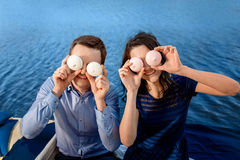 Young couple have fun with cakes near water Stock Images